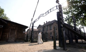 Pope Francis walks through the gate of Auschwitz on Friday.