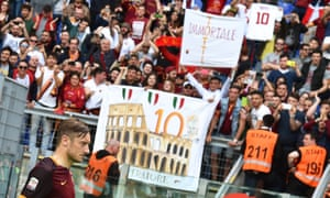 The fans pay tribute to Roma's Francesco Totti, who would only say 'we'll see' when asked about his future after the game against Chievo.