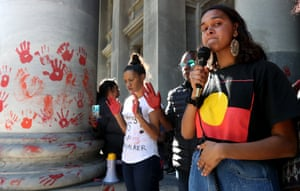 Adelaide, Australia. Samar Brown-Fernendez, a family member of 19-year-old Kumanjayi Walker, who died after being shot by police on Saturday night, speaks during a protest outside the South Australian Parliament. Aboriginal and Torres Strait Islander communities and friends are calling for justice for the teenager
