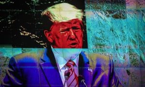 Displayed on a monitor, Donald Trump addresses the United Nations general assembly in New York City on the day that congressional Democrats announced a formal impeachment inquiry.