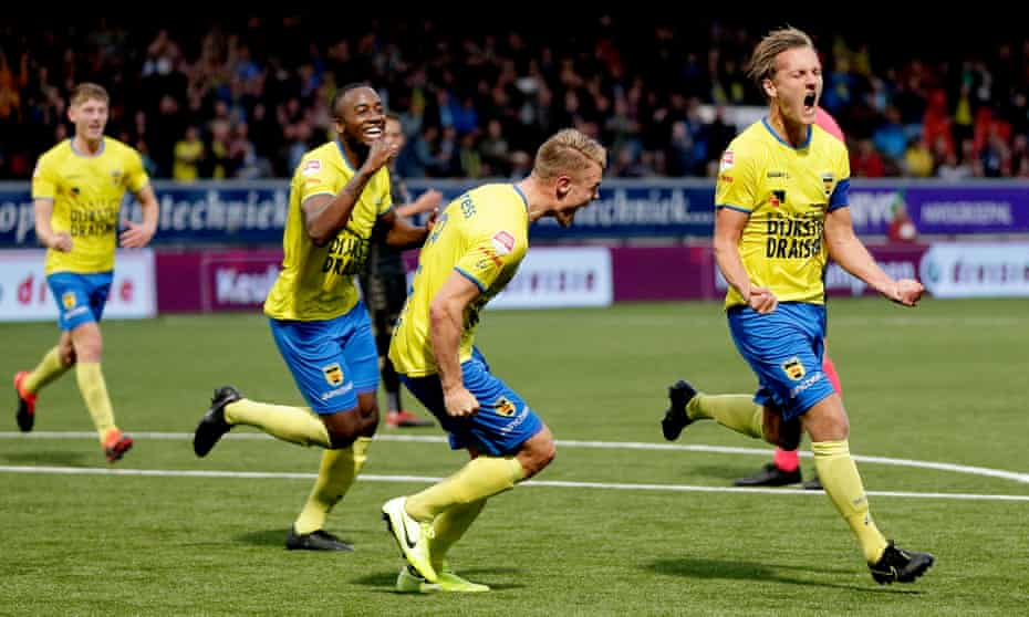 Erik Schouten (right) celebrates scoring for Cambuur during their dominant season which looked sure to end in promotion to the top flight.
