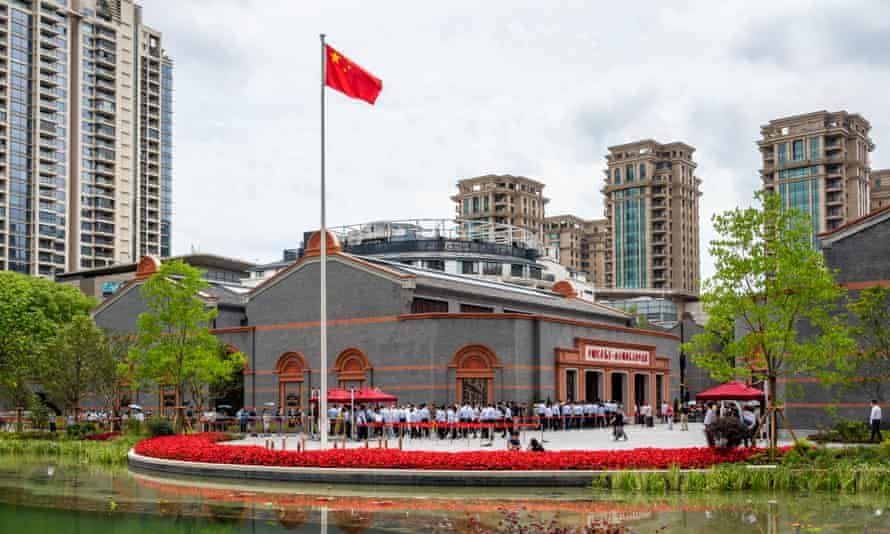 Residents line up in front of the memorial hall at the site of the National Congress of the Chinese Communist Party in Shanghai, China, June 8, 2021
