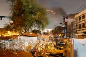 protesters throw firework in Thailand