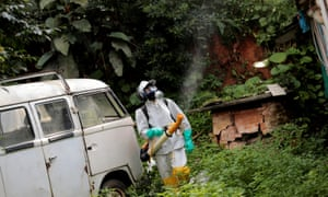 A State Endemics Control health agent fumigates insecticide in an area to kill mosquitoes during a campaign against yellow fever in São Paulo