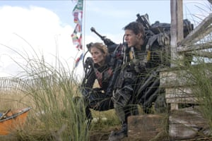 'Invaders invade' … Emily Blunt and Tom Cruise in Edge of Tomorrow, whose co-writer, Christopher McQuarrie, has complained about studio interference with the script.