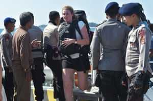 A foreign tourist arrives from Gili Trawangan island, in Bangsal, North Lombok. More than 1,000 tourists have been evacuated from Indonesia's tiny Gili islands.