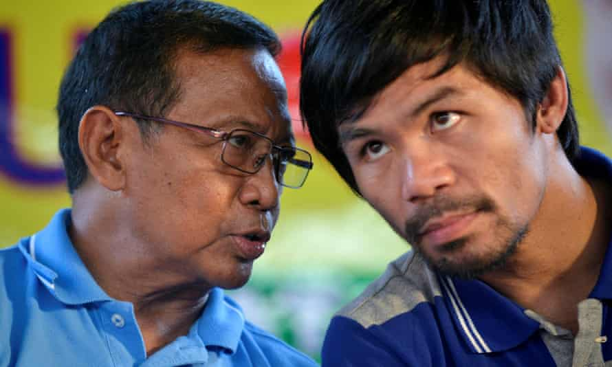 Presidential candidate Jejomar Binay, left, talks to boxer Manny Pacquiao during an election campaign stop in Dasmarinas.