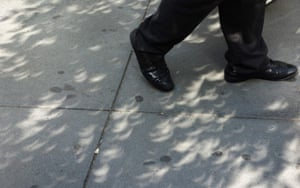 A man walks along 42nd street as shadows of the eclipse are cast throuogh tree leaves on the sidewalk August 21, 2017 in New York. Emotional sky-gazers stood transfixed across North America Monday as the Sun vanished behind the Moon in a rare total eclipse that swept the continent coast-to-coast for the first time in nearly a century. / AFP PHOTO / DON EMMERTDON EMMERT/AFP/Getty Images