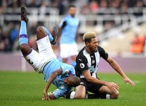 Joelinton is brought down by Fernandinho.