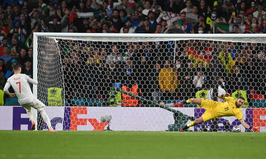 Gianluigi Donnarumma saves Álvaro Morata's spot kick in the penalty shootout.