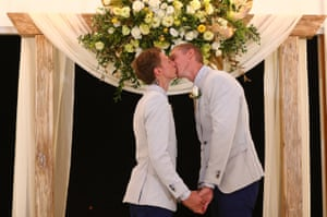 Craig Burns and Luke Sullivan kiss during their wedding ceremony at Summergrove Estate in Gold Coast.