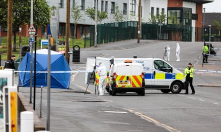 A police forensic science team at work at the scene in Blackburn on Sunday.