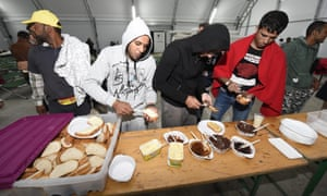 People arriving from Hungary are given food at a reception point in Nickelsdorf, Burgenland, Austria.