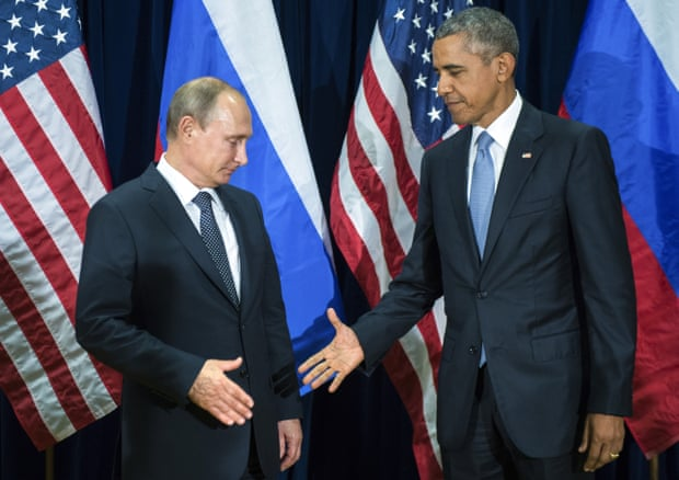 Frosty ... Barack Obama attempts to shake hands with Vladimir Putin