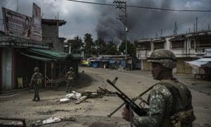Soldiers patrolling Marawi during heavy fighting in June 2017.
