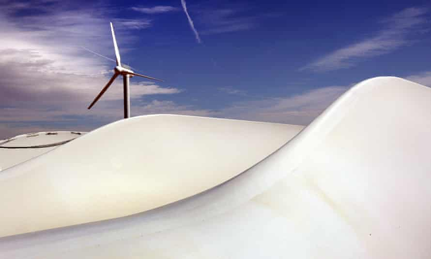 A wind turbine and, in the foreground, giant turbine blades, at the US-government-owned National Renewable Energy Laboratory on the outskirts of Boulder, Colorado