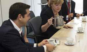 Greece's prime minister, Alexis Tsipras, and Germany's chancellor, Angela Merkel, meet at the European Union headquarters in Brussels on 7 July, ahead of an emergency EU summit after Greeks voted no to further austerity in a referendum.