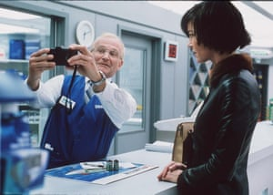 Icy genius … Robin Williams with Connie Nielsen in One Hour Photo.