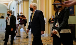Mitch McConnell walks from the Senate chamber in Washington DC Thursday.
