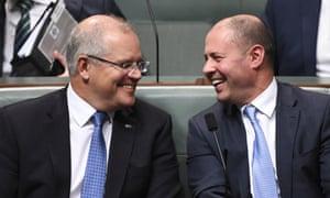 Australian Prime Minister Scott Morrison (left) and Australian Federal Treasurer Josh Frydenberg react during House of Representatives Question Time at Parliament House in Canberra, July 31, 2019.