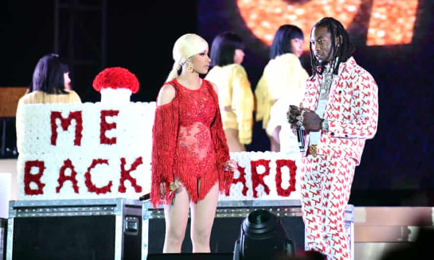 Cardi B is presented a 'Take Me Back' card onstage by her husband Offset.