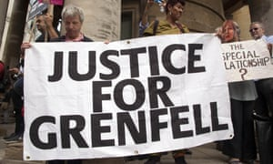 A banner for the Grenfell survivors at an anti-austerity march held in London.