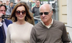 Marie-Josée and Henry Kravis walk past the Hotel Taschenbergpalais in Dresden, Germany