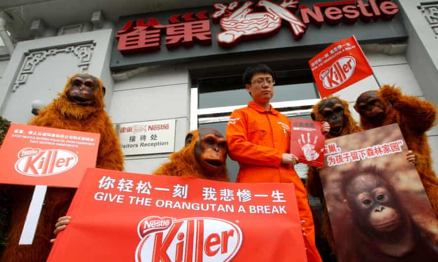 Greenpeace volunteers in orangutan costumes protest outside the offices of Nestlé in Beijing, March 2010