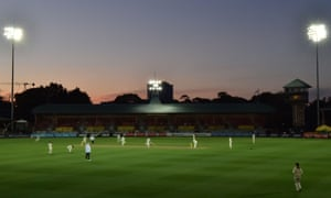 The sun sets over the North Sydney Oval as Australia's bowlers turn the screw on the first day of the women's Ashes cricket Test against England.