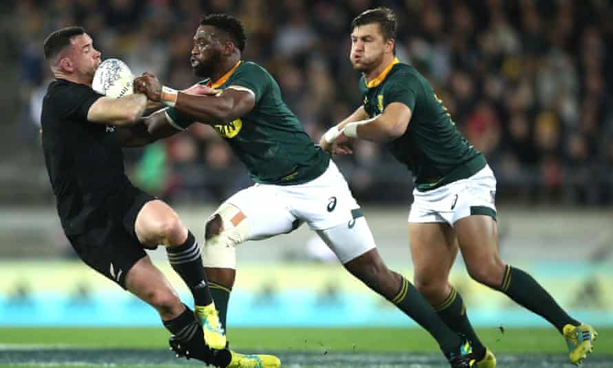 Kolisi tackles Ryan Crotty during South Africa's landmark win over the All Blacks.