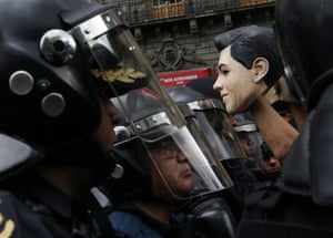 Mexico City, Mexico A protester holds a mask resembling President Enrique Peña Nieto during a demonstration against education reforms