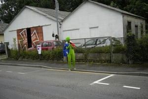 Stage 18: all dressed up. A lone spectator waits for the peloton to pass from Pau to Luz Ardiden