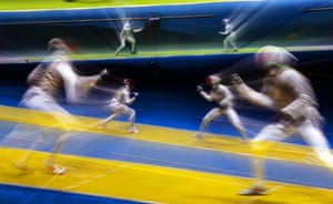 Peter Joppich (L) of Germany in action against Enzo Lefort (R) of France during the men's foil individual round of 32.