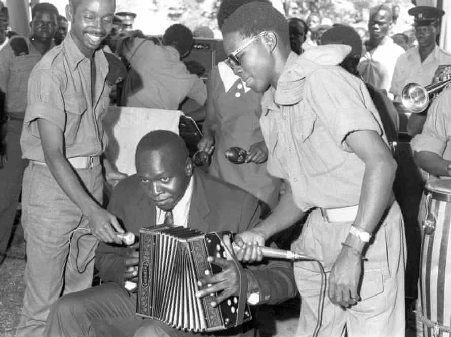 Idi Amin playing the accordion at Buvuma Island in 1971.