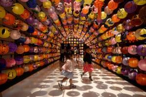 Kuala Lumpur, Malaysia Children play under a lantern installation before the mid-autumn festival at a shopping mall in Kuala Lumpur