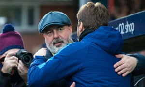 Mauricio Pochettino congratulates Rochdale's manager Keith Hill after the third-tier side's dramatic draw with the Premier League giants at Spotland.