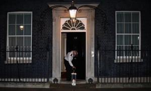 A candle lit by Prime Minister Boris Johnson and his fiancee Carrie Symonds is placed on the doorstep of 10 Downing Street.