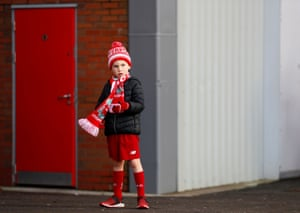 A young Liverpool fan outside Anfield before watching his team beat Brighton 2-1. Liverpool have registered 14 consecutive home wins in the Premier League, their second longest home top-flight winning run behind a 21-game streak between January and December 1972.