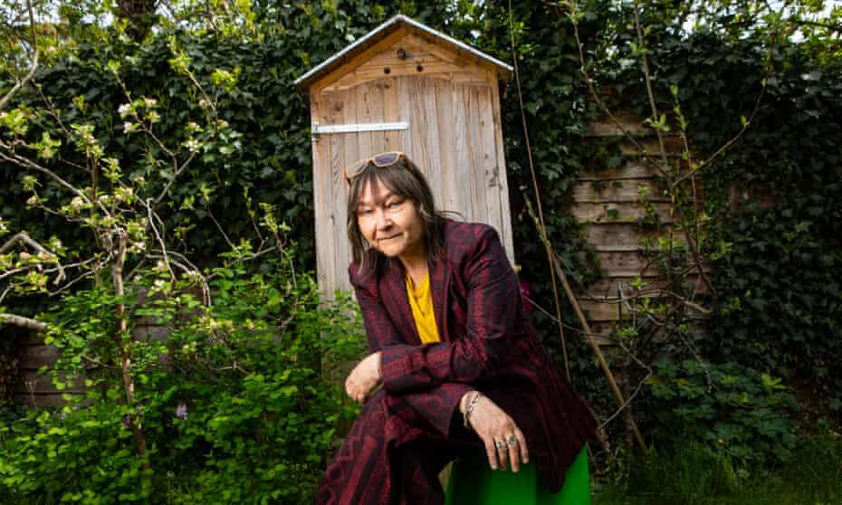 Ali Smith in her garden in Cambridge