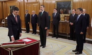 Pedro Sanchez is sworn in as Spain's prime minister, witnessed by King Felipe VI, centre, and former PM Mariano Rajoy, right.
