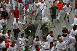 Running with Cebada Gago's fighting bulls entering the bullring during the second day of the festival