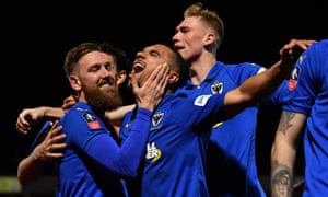 AFC Wimbledon's Scott Wagstaff celebrates scoring their third goal with Kwesi Appiah as The Dons beat West Ham 4-2 at Kingsmeadow.