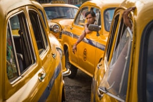 Taxis and a driver in Kolkata