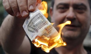 a protestor burns a euro note in athens in june 2015