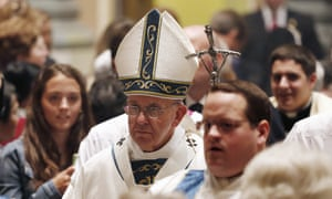 Pope Francis walks toward the altar at Cathedral Basilica of Sts Peter and Paul during a mass on Saturday.