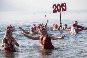 Swimmers take part in a New Year's Day dip in Lake Maggiore in Switzerland