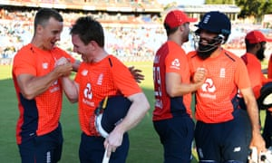 Tom Curran (left) and Eoin Morgan celebrate as Dawid Malan congratulates Moeen Ali after the match.