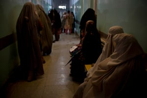 Women wait to see a doctor in the Obstetrics unit of Mirwais Hospital