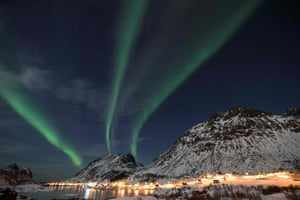 The northern lights dance across the sky above Unstad