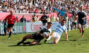 Blaine Scully of the US goes over for their first try.